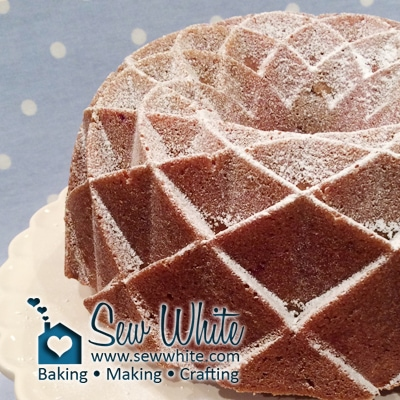 jubilee bundt cake with a dusting of icing sugar on