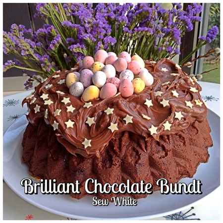 Brilliant chocolate bundt cake decorated as an Easter nest cake with chocolate ganache and mini eggs