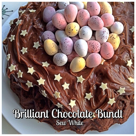 chocolate bundt cake decorated with buttercream and mini eggs for an easter nest cake