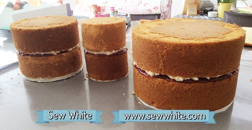 Three tiers of cake ready to be stacked