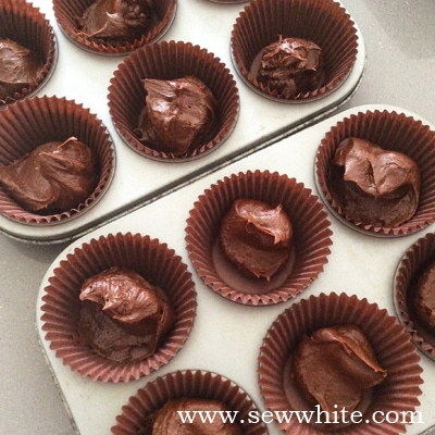 chocolate cakes in cupcake cases ready to be cooked