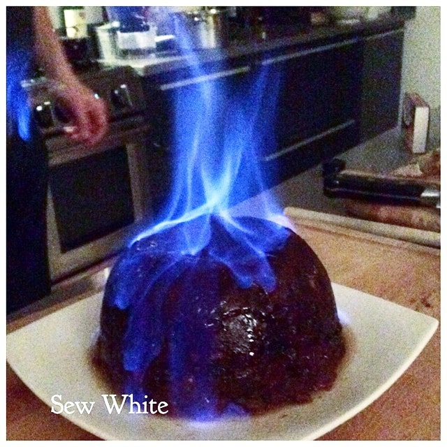 Christmas Pudding on fire with blue flames ready to be served