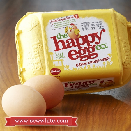 Happy eggs box with two eggs