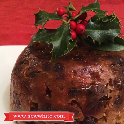 close up of fresh holly on an English Traditional Christmas Pudding