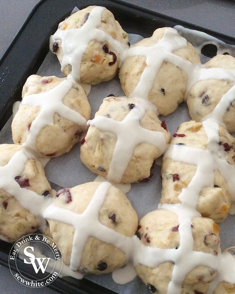 Drawing the cross on the hot cross buns.