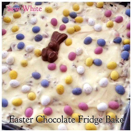 Easter Chocolate Fridge Tray Bake decorated with mini easter eggs and chocolate malteser bunny