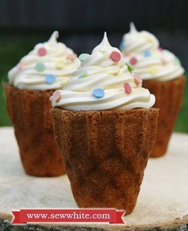 ice cream cone cakes decorated with swirl buttercream and sprinkles