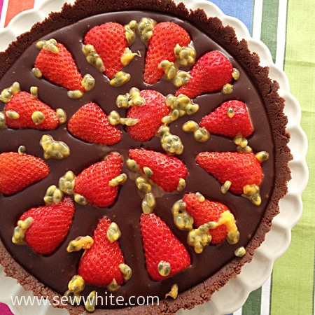 ready to serve the Chocolate tart with Strawberries and drizzled with Passion Fruit