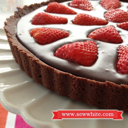 crisp tart shell with chocolate and strawberries