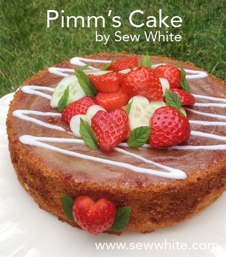 Pimm's Cake topped with strawberries and cucumeber hearts and sprigs of mint