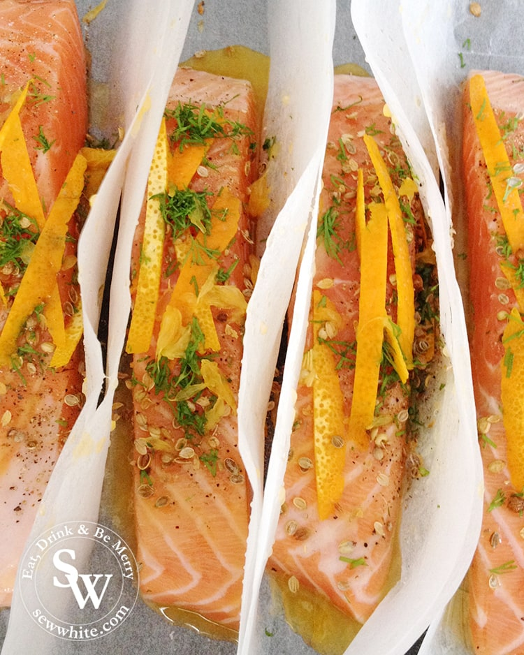 Spiced Orange Salmon Parcels with orange zest, fresh herbs and spices