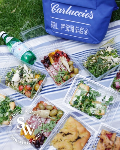 a range of the Carluccio's Picnic items on a blanket ready to enjoy
