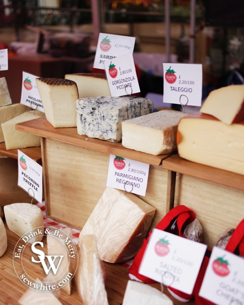 cheese stall with lots of cheese types