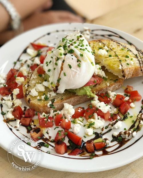 sourdough toast with poached eggs and feta cheese