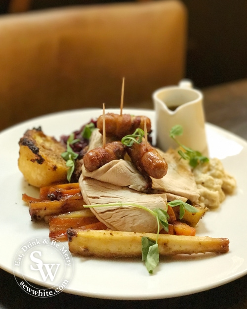 A beautiful roast dinner with turkey and pigs in blankets at Fire Stables Wimbledon Christmas reveal