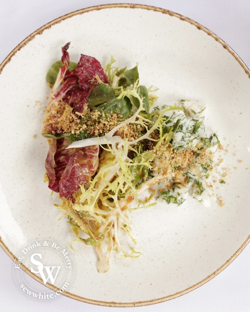 The fresh and vibrant crab salad with crunchy leaves.
