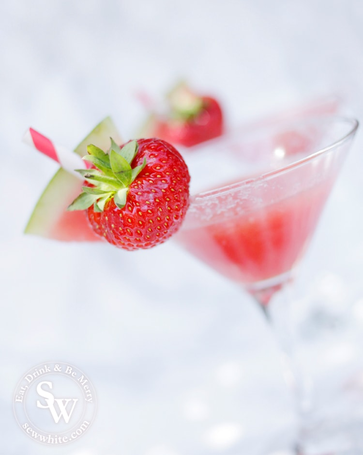 watermelon slice and strawberry on a martini glass