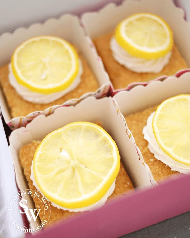 golden brown traybake topped with fresh lemon. Lemon curd centre