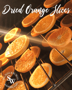 dried orange slices drying out in the oven for Christmas