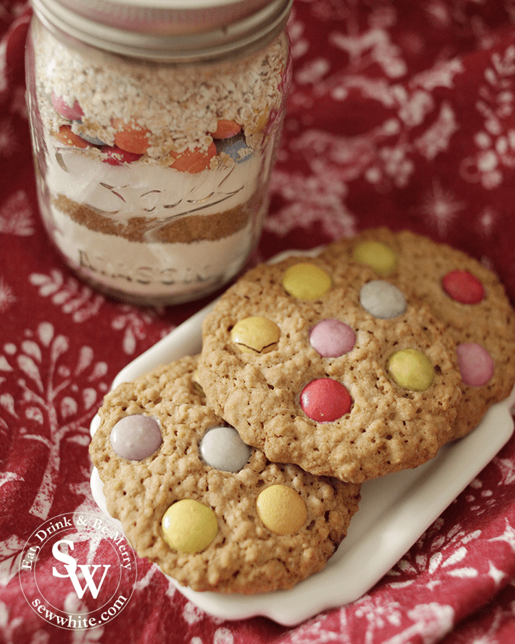 Cookies made from the cookie jar next to a jar of mix ready to give for a birthday or christmas present