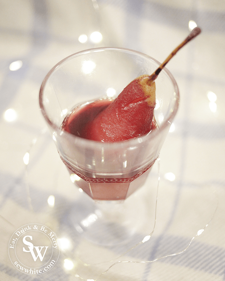 Mulled Wine Poached Pears served in a glass goblet
