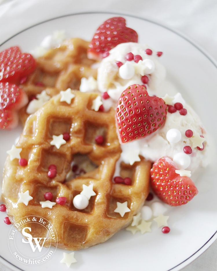 doughnut waffles covered with sprinkles and served with ice cream
