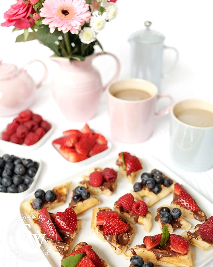 Waffle bites with chocolate hazelnut spread topped with fresh fruit. Perfect for afternoon tea. Recipe by Sisley White at Sew White