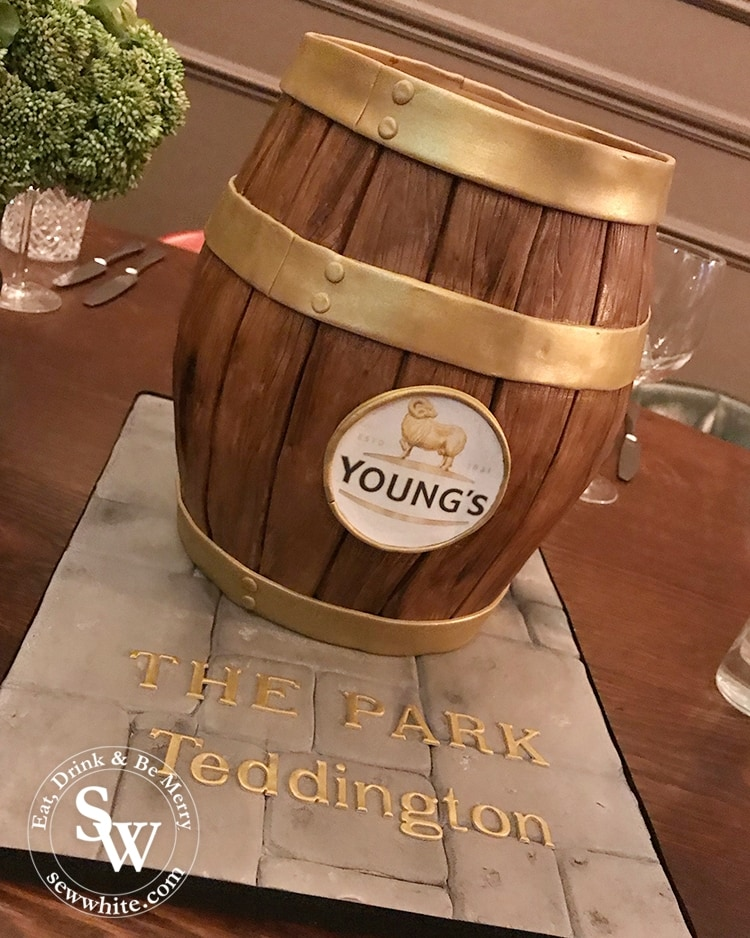 A youngs pub cake made to look like a barrel by Bec's Bakes