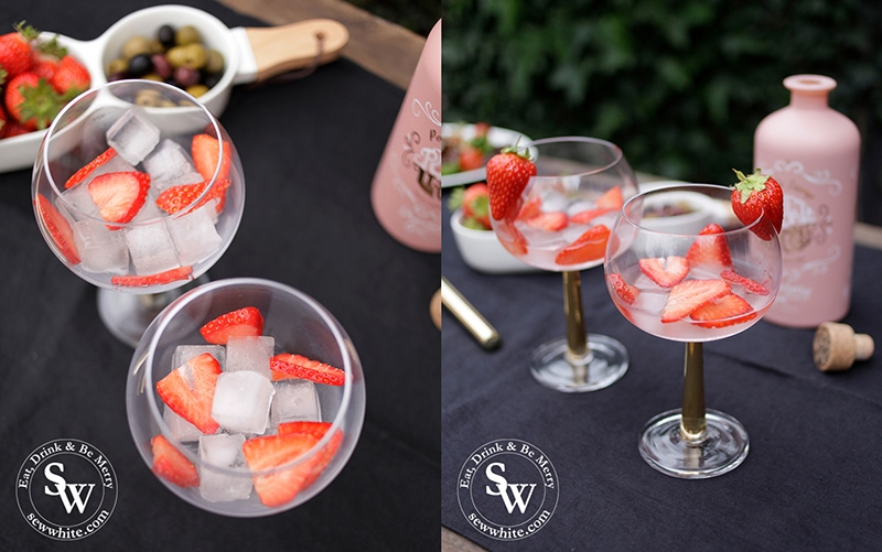 How to make a Strawberry Gin and Tonic perfect for Wimbledon. Ice cubes and strawberry slices in a glass from Elys Wimbledon.