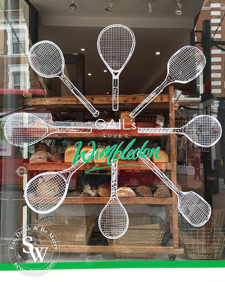 The hand drawn wimbledon inspired motif on Gail's bakery window in wimbleon village.