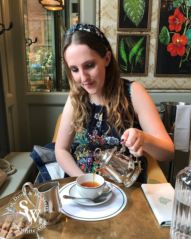 Sisley white pouring her pot of tea at The Ivy Cafe in Wimbledon Village
