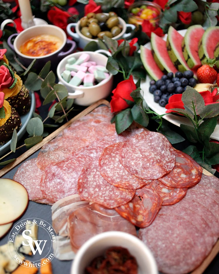 A close up of the charcuterie board on the graze table and the graze board.