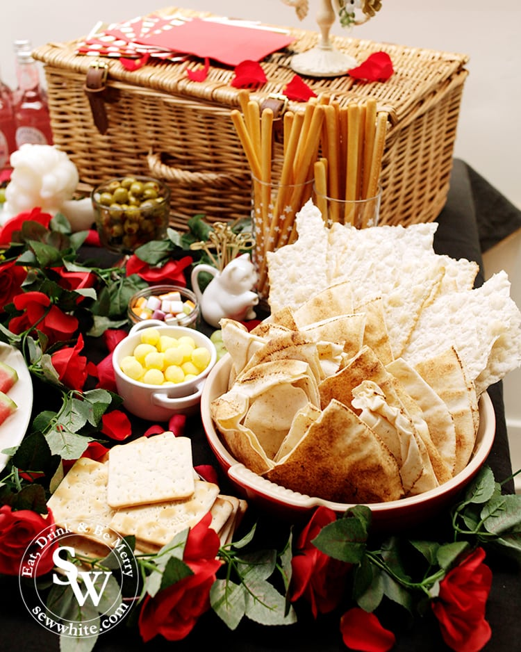 A range of bread, flat breads, crackers and breadsticks on the graze table catering for gluten free, vegan diets at the Beauty and the Beast Party