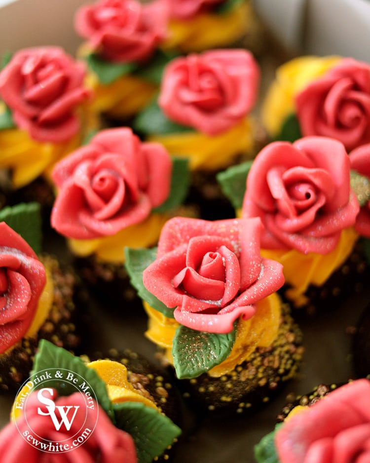 The most perfect cakes for the Beauty and the Beast Party. Chocolate cake pops topped with edible red roses on yellow buttercream.