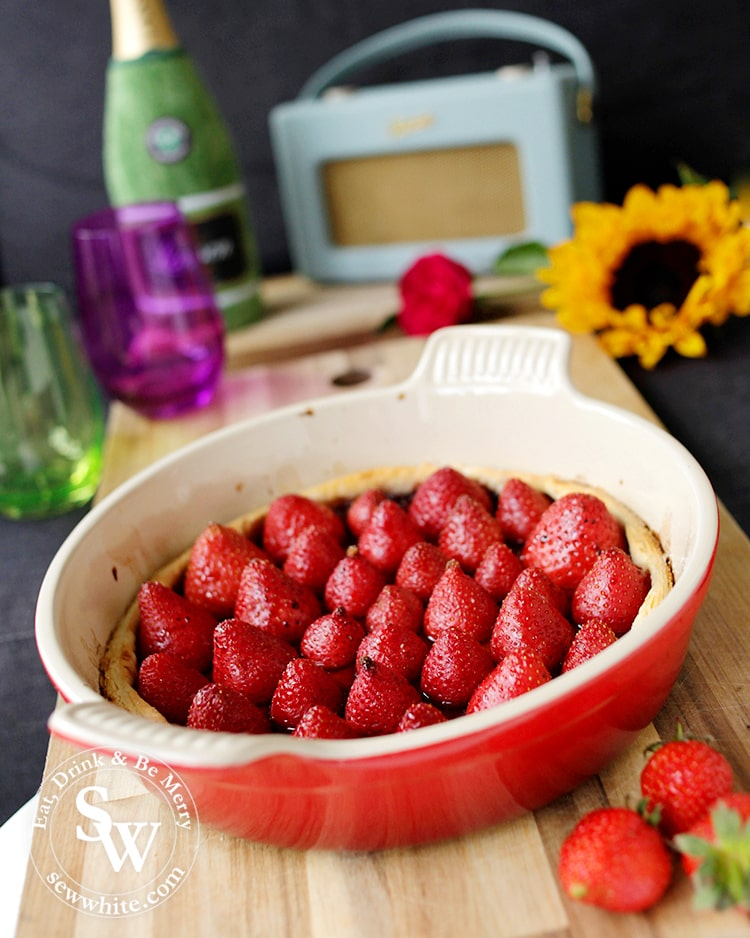 Golden pastry crust tart filled with strawberries baked in vanilla and balsamic vinegar. Recipe for Balsamic Vanilla Strawberry Tart.