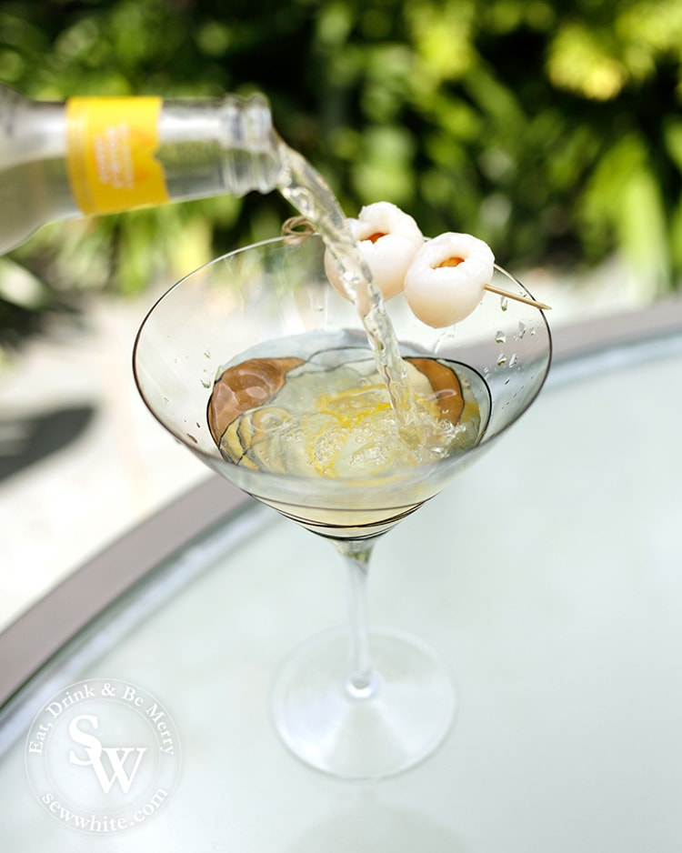 easy cocktail recipes lemonade being poured into a lychee martini