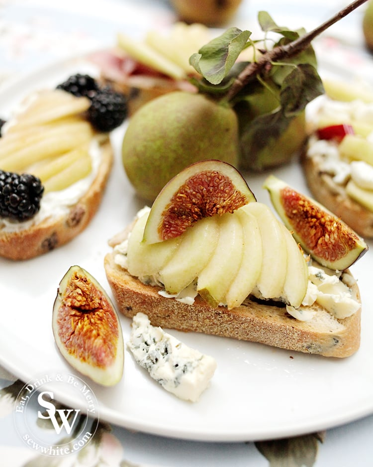 food porn Pears on toast with blue cheese and figs. Red figs on pear slices with blue cheese underneath on sourdough toast