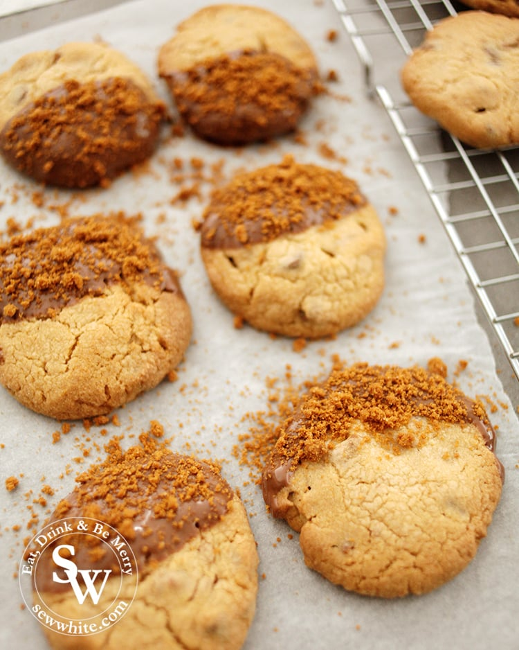 Golden baked Biscoff cookies dipped in chocolate and topped with biscoff biscuit crumbs for decoration