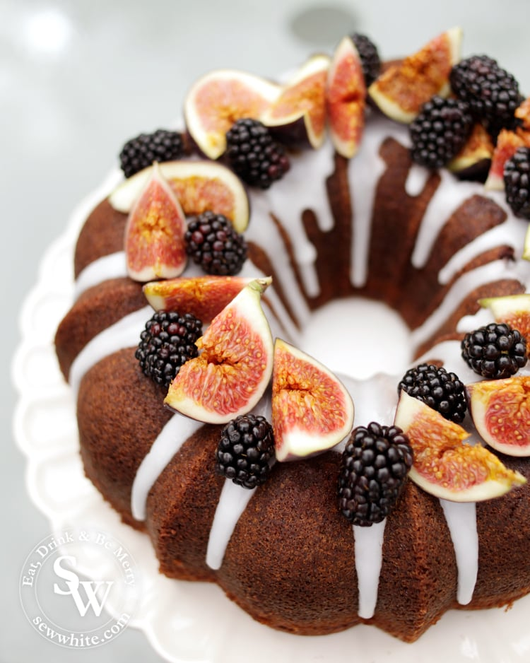 Blackberry and Ginger Cake autumn cake on a drizzle of white icing on a nordic ware bundt tin.