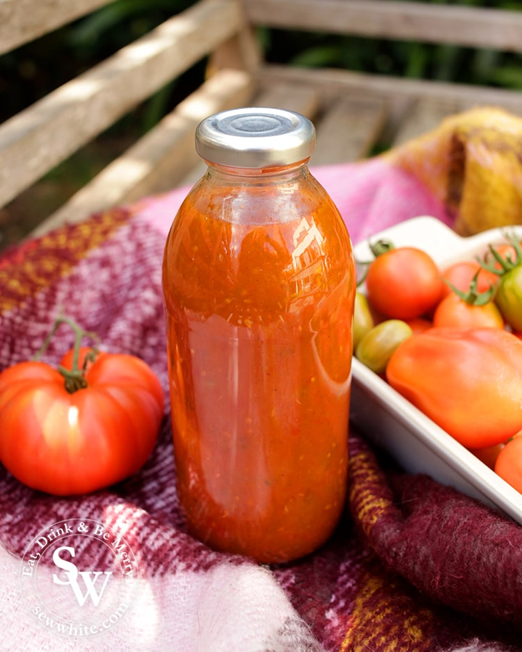 Freshly made tomato ketchup next to the vegetable garden.