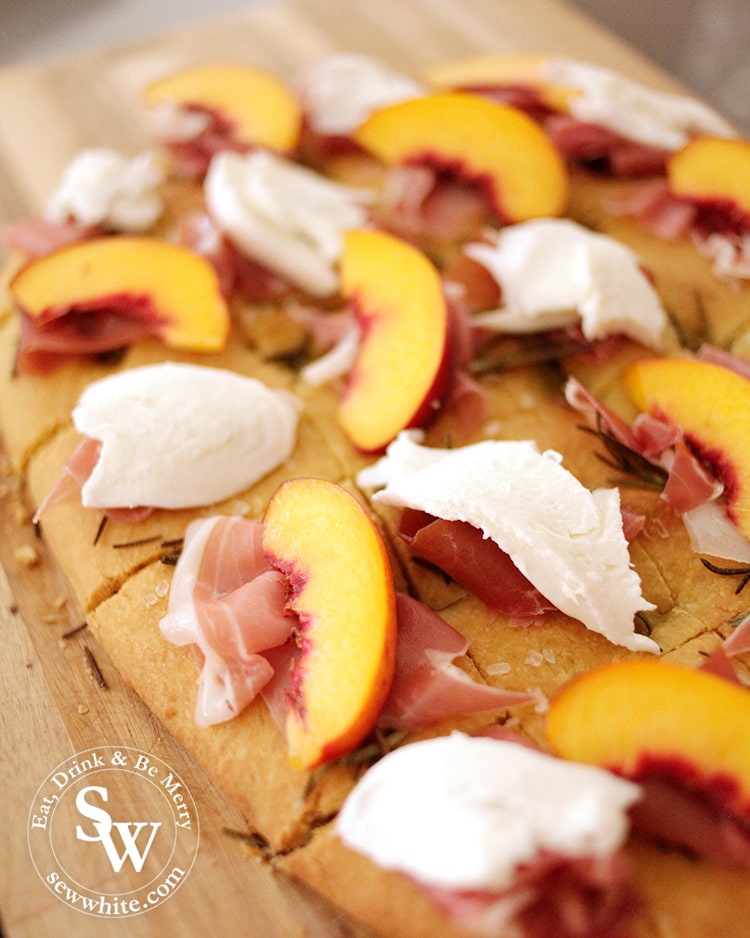 A close up of the peach and parma ham on the focaccia sharing bread.