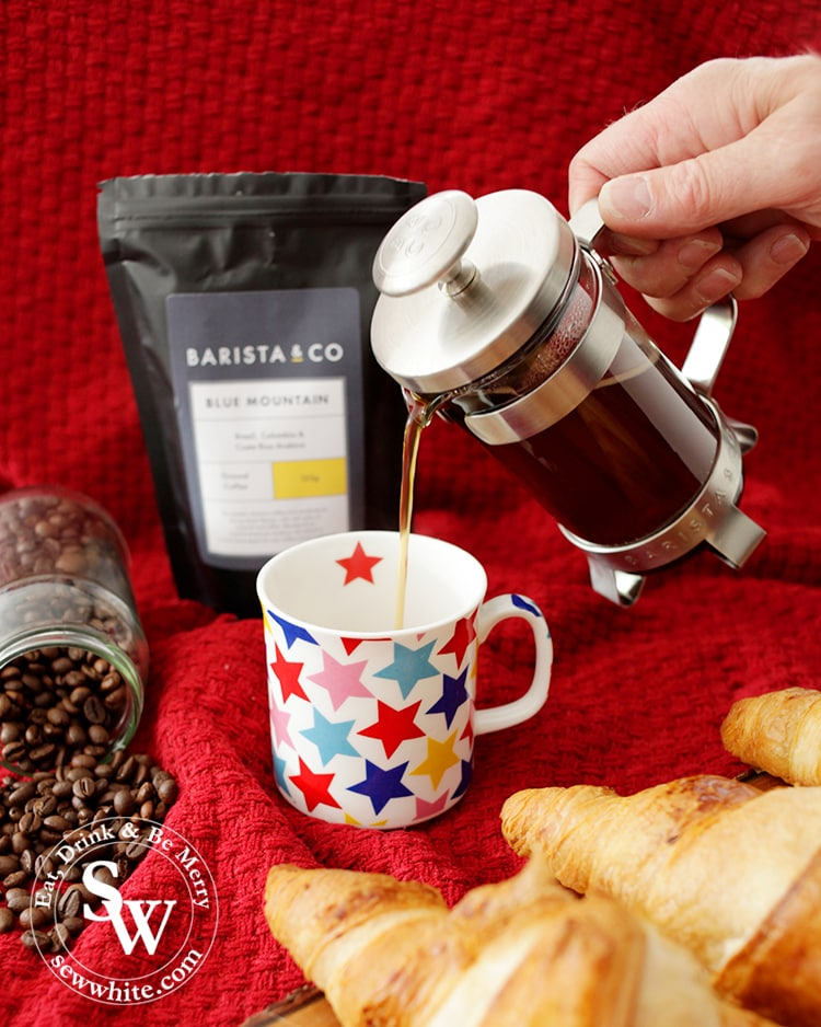 Pouring coffee from a barista and co french press for christmas morning in the Top 5 Drinks for Christmas 2019