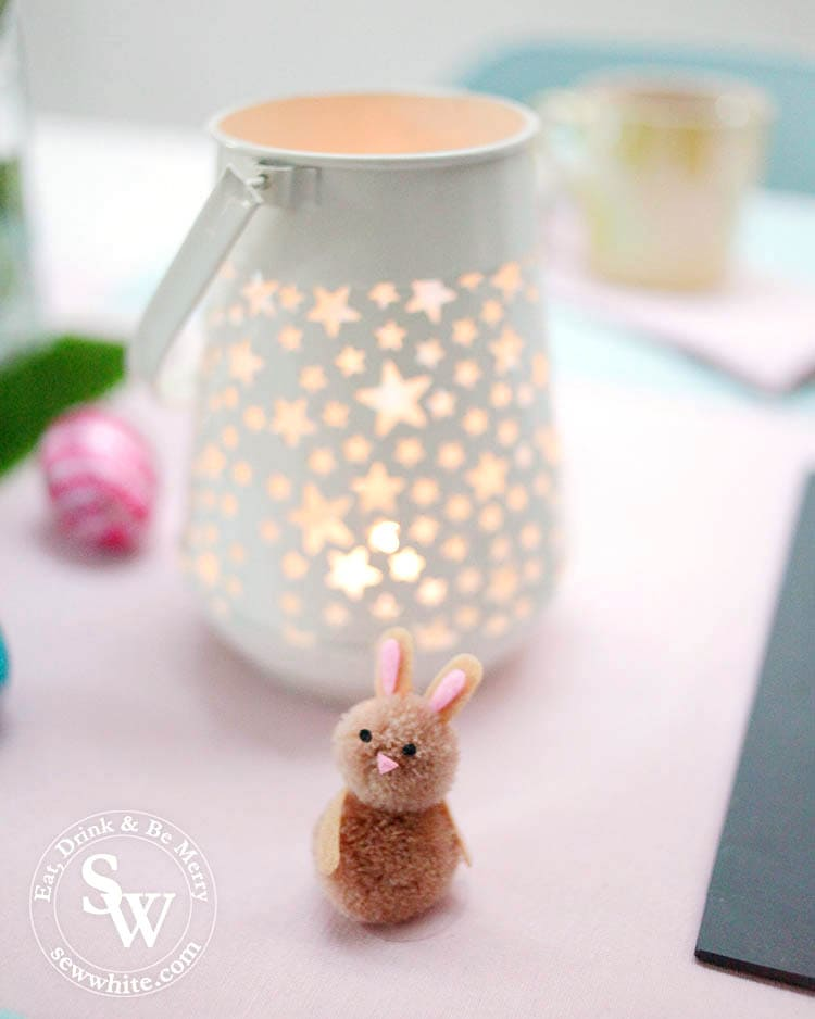 white star lanterns with pom pom Easter rabbits on the Easter Table Inspiration