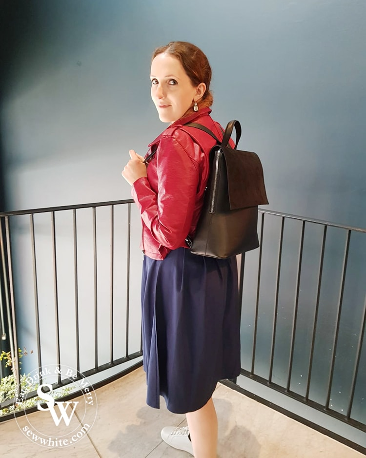 Sisley White wearing the black dahlia bag from Lawful London