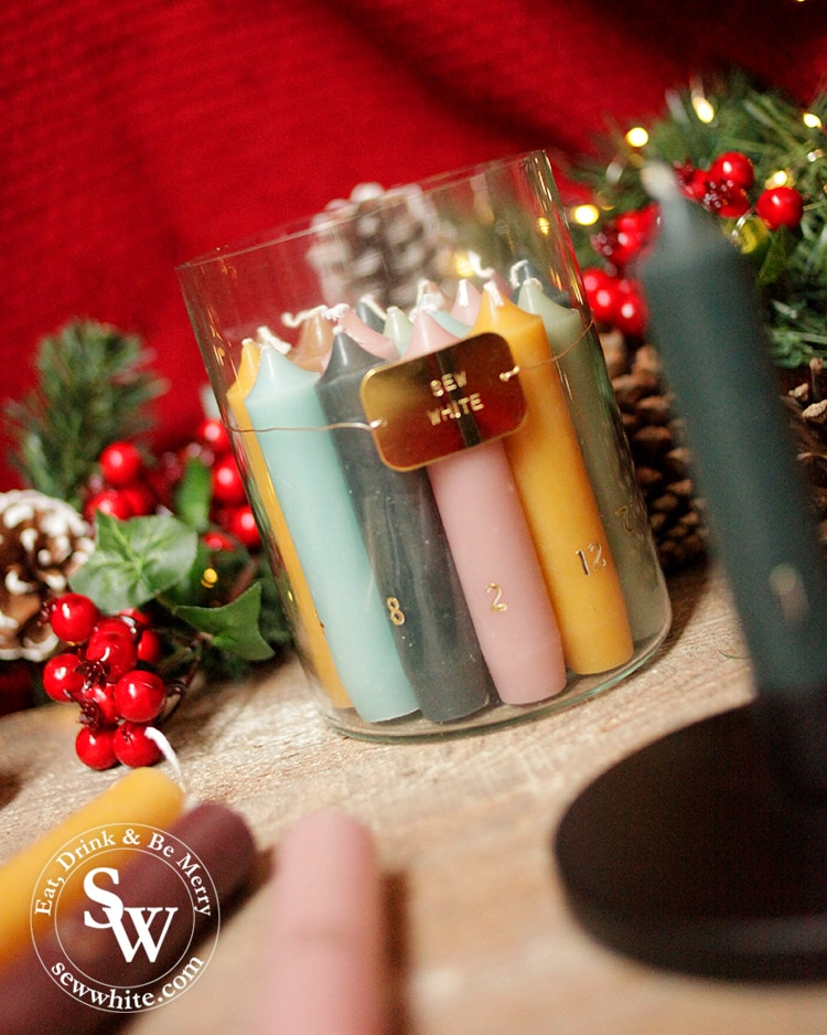 personalised advent candle set from forest and co with sew white written on.
