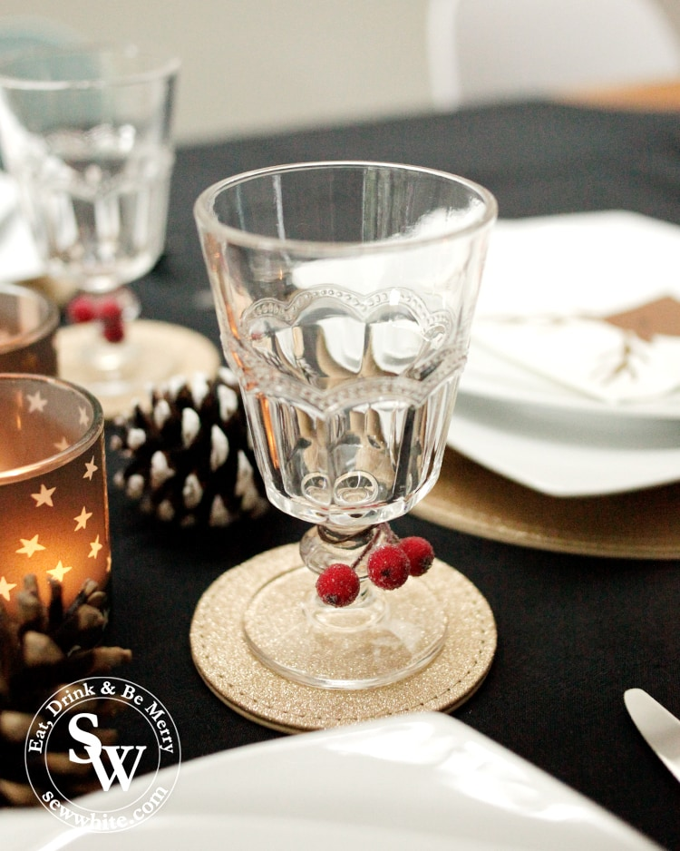 Adding a little bit of colour to the glasses with fake berries on the Christmas table.