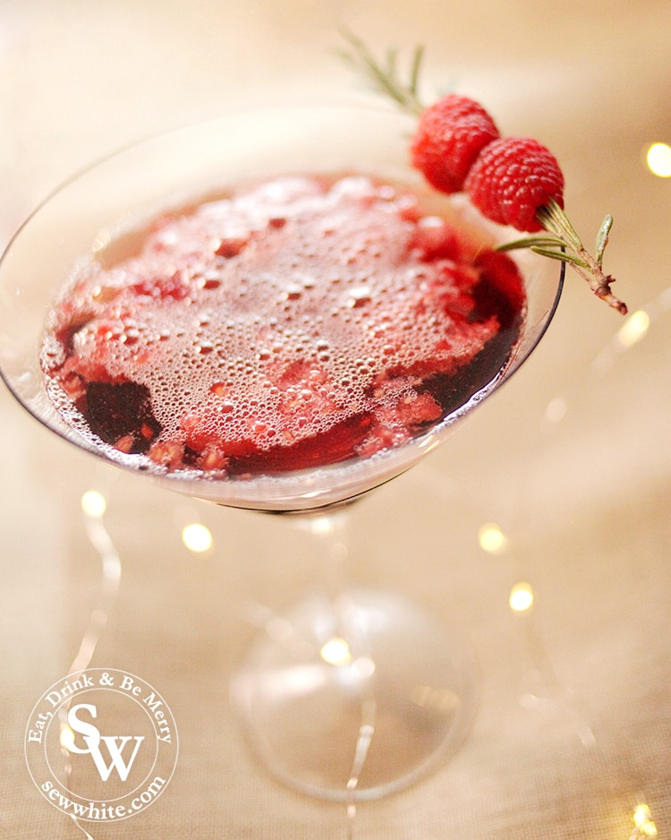 easy cocktail recipes red cocktail rum and raspberry cocktail with raspberry on the side.