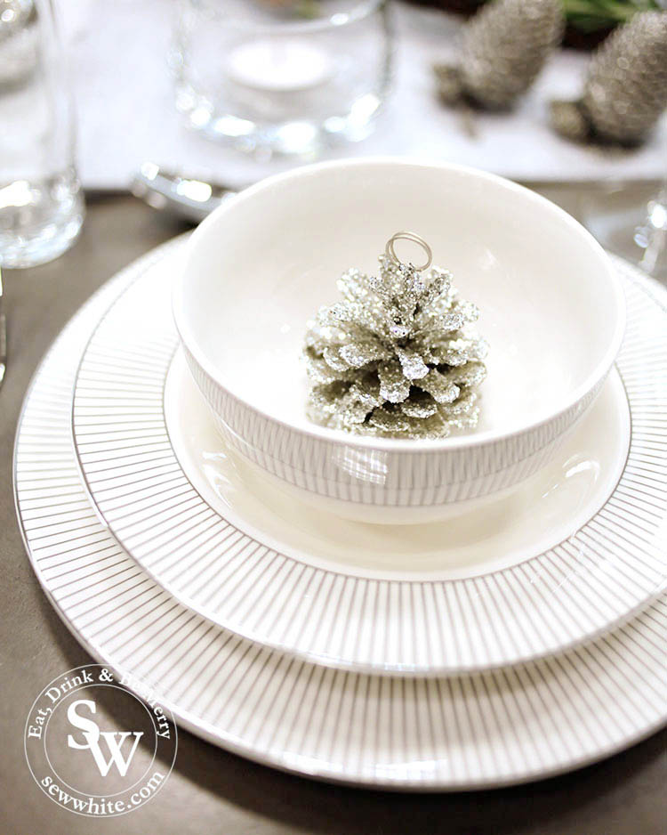 silver pine cone place setting. Silver Christmas Table Inspiration