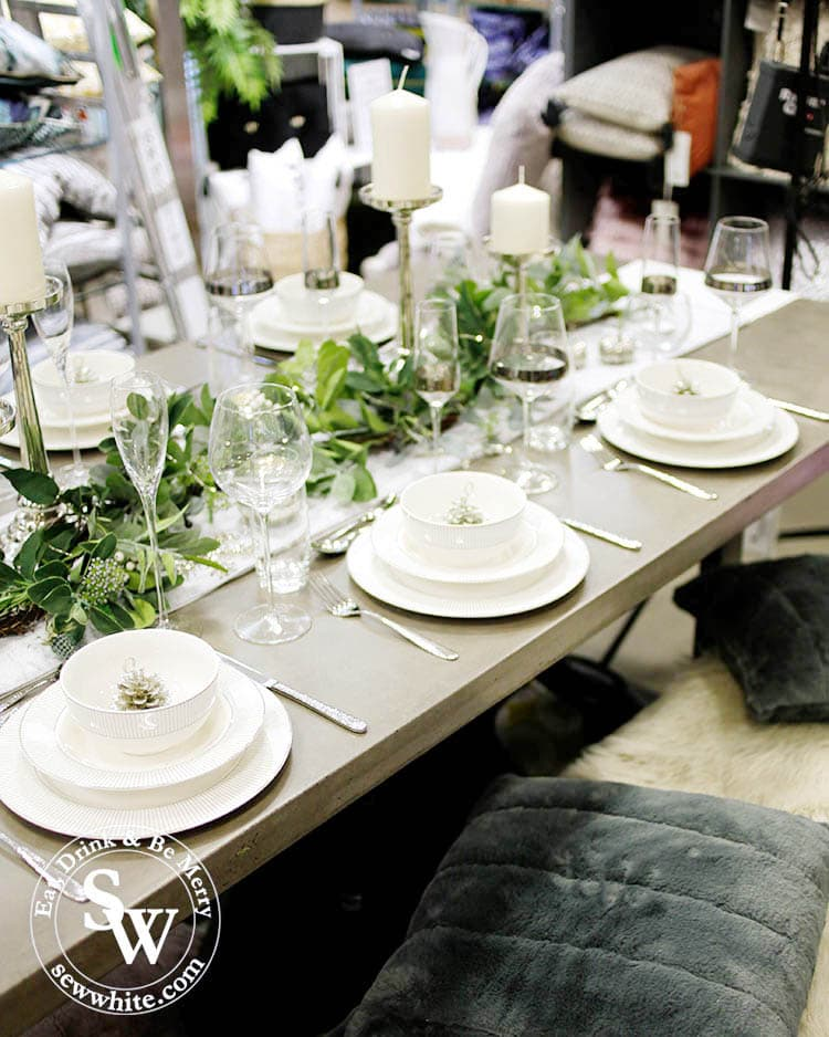 A gorgeous silver, white and green table setting for Christmas 2019 and Elys Wimbledon. Fur blankets and cushions used for seating.