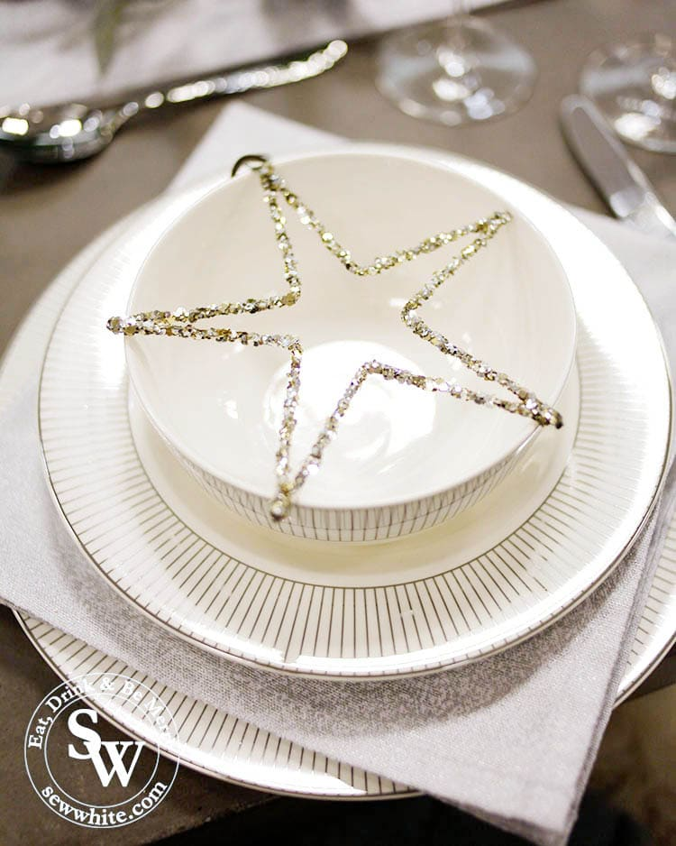 The white company star lent on crockery for a Silver Christmas Table Inspiration